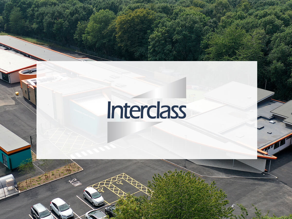 Interclass logo on background with building and car park