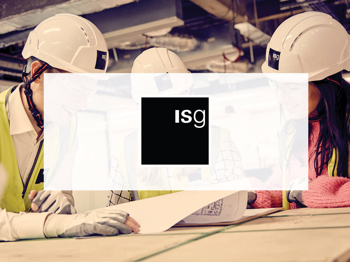 ISG logo on background with people wearing hats