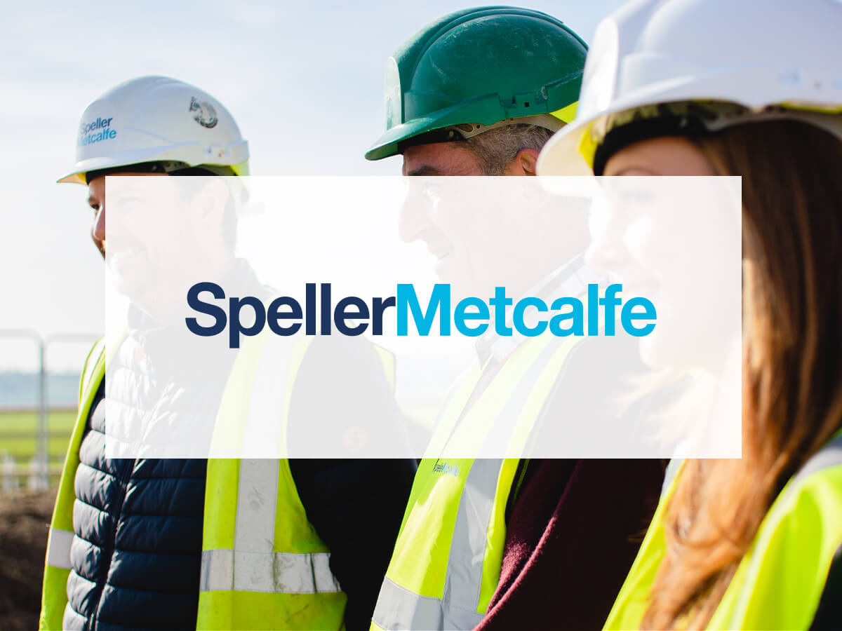 speller metcalfe logo on background with people wearing hard hat