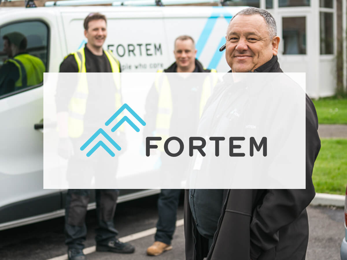 Fortem logo on background of employees and van