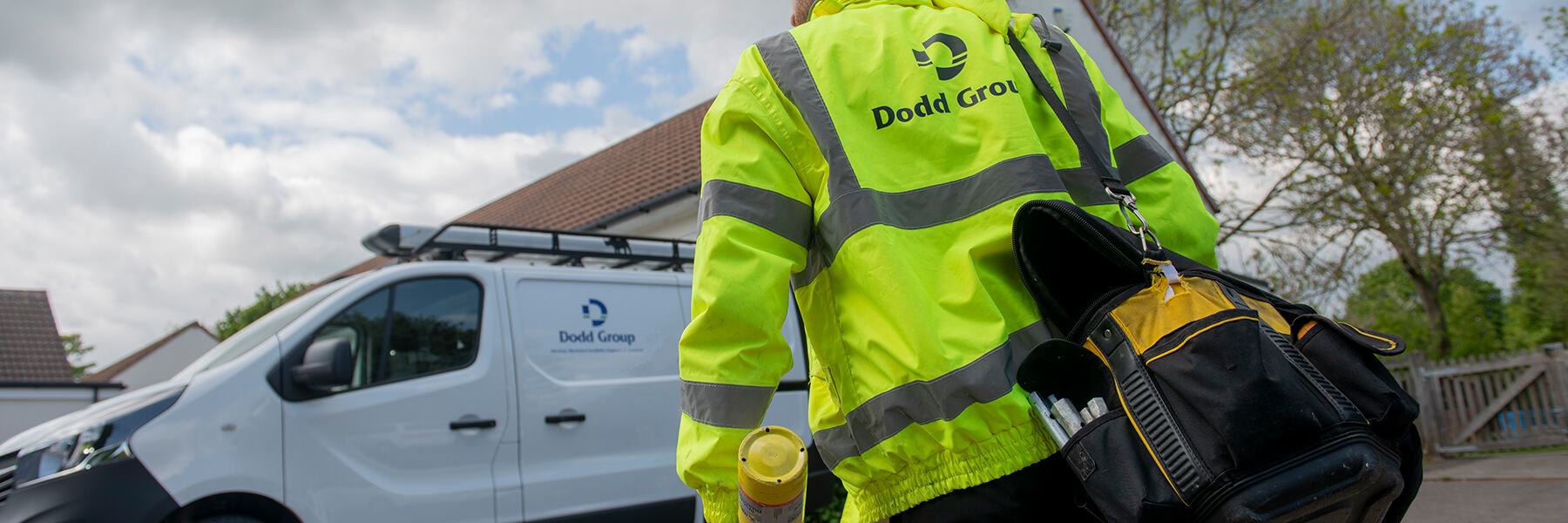 Van and man wearing high vis, Dodd group logo on both